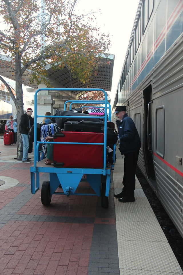 With the Dallas-bound baggage unloaded from the Baggage Car, Conductor Doyle prepares to load the originating baggage at Dallas for future points.<br /> (Photo by William A. Shaffer)