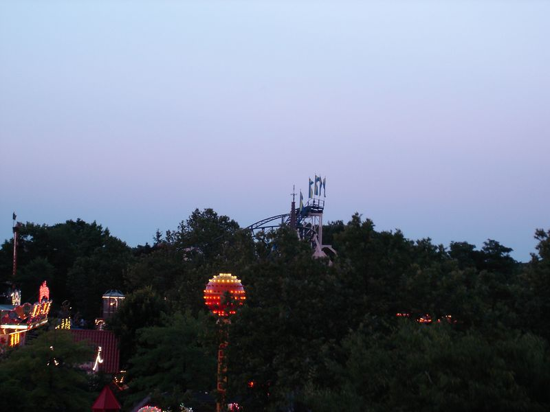 An aerial shot from the Ferris Wheel - while you can't see all that much - you get an idea for the heavy tree cover that Adventureland has as well as the lift hill for the Hurricane & Music Express