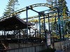 Klondike Goldrusher is a Zamperla Zig Zag coaster (Wild Mouse coaster) - it was installed in 2002 and they run it brakeless.  Unfortunately, they only run one train on the course at a time.