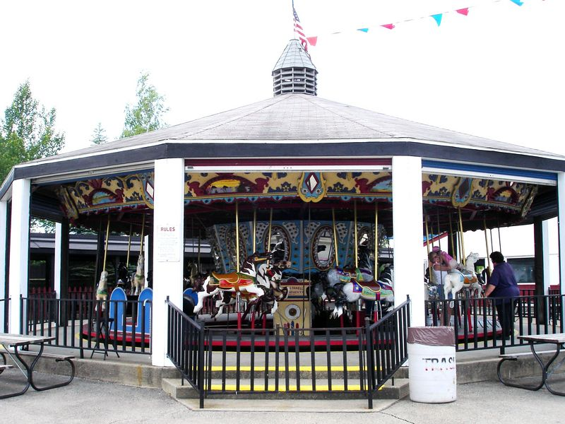 Little A's carousel is a 1950's Allan Herschell metal carousel.  It's in very good shape.  It has 30 jumpers and 2 chariots.