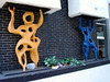 Cool sculptures created by sculptor Gerard Tempest hold up the front of the Rivoli Theater.