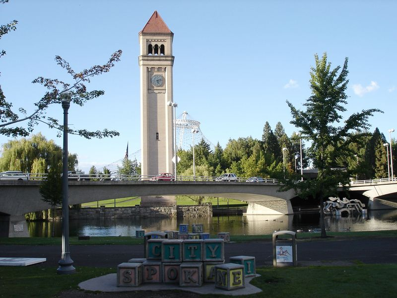 An establishing shot of the park with it's clock tower, waterway, and big blocks.