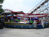 Tilt-A-Whirl with the Tornado and station behind.