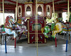 The carousel has a classic Herschell frame and a nice Stinson band organ.  The horses are newer, crudely painted fiberglass.