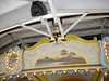 The roof of the carousel moves with the building.  Here you can see part of the mechanism for this.