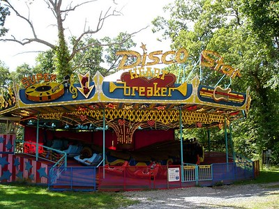 The Heartbreaker - Flying Bobs style ride - plays non-stop 70's disco all day.   This ride was moved from elsewhere in the park to this location in 2002 to give the Wildcat a little company.