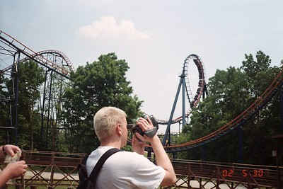 Me taking a picture of Josh videoing Vortex, one of the most twisted roller coasters around.  Not horrible, but certainly not very good.  It was a credit.