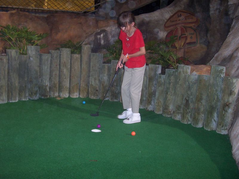 Mini Golf at Congo River golf- Amber can't believe that she missed when she was this close!