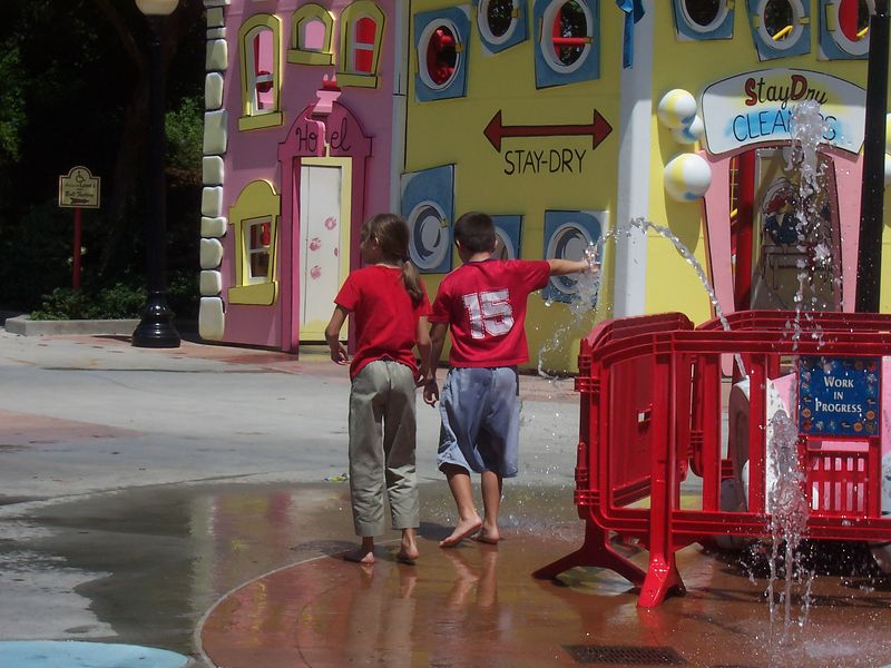 Amber and Joseph playing in the Curious George water play area
