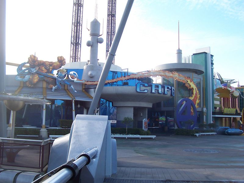 Coming accross that bridge, the first thing you see (if you don't look up that is) is the Fantastic Four cafe.  The entrance to the Hulk is to the left.