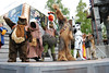 """The """"space village people"""" at Hyperspace Hoopla singing Y O D A - cowboy ewok, construction worker jawa, native american gammorean guard, navy Chewbacca, police man stormtrooper and biker ewok"""