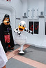 Darth Goofy watches as Donald goes on the attack