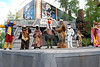 "The ""space village people"" at Hyperspace Hoopla singing Y O D A - cowboy ewok, construction worker jawa, native american gammorean guard, navy Chewbacca, police man stormtrooper and biker ewok"