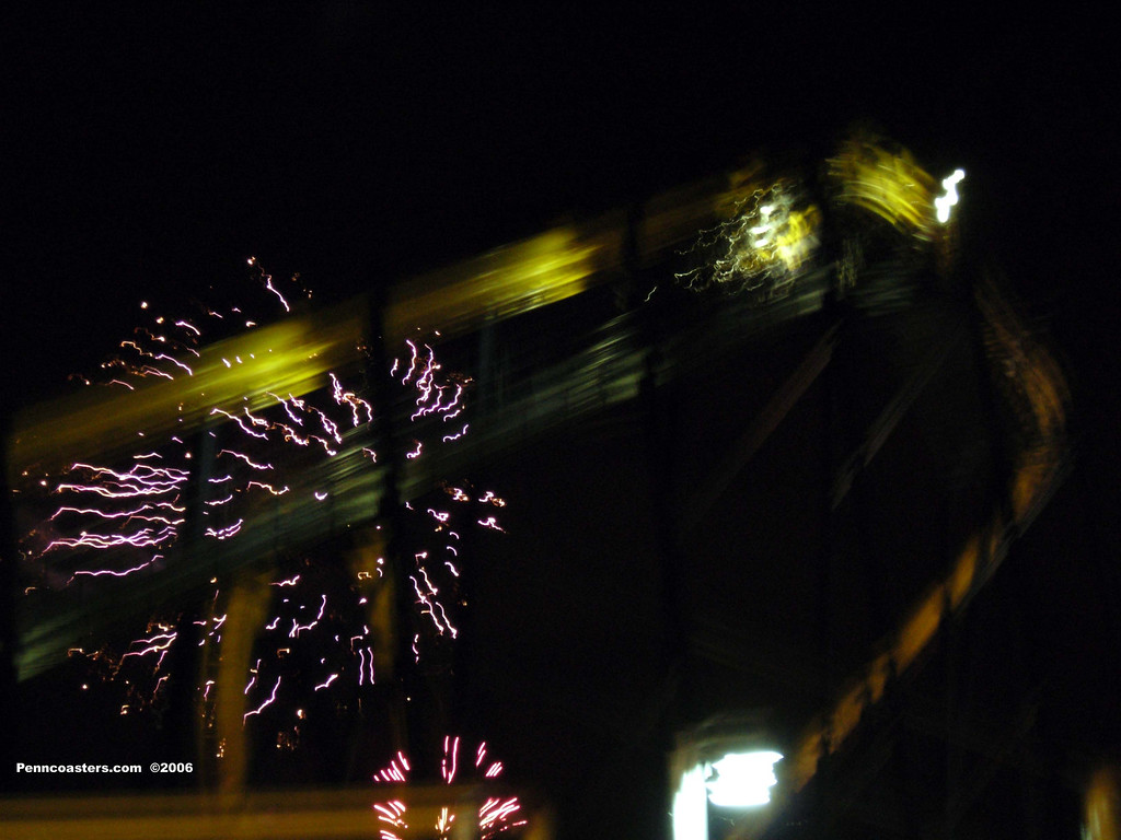 Blurry fireworks shot with Batman: The Ride in the forground.  It is a lousy shot, but I kinda like it at the same time.