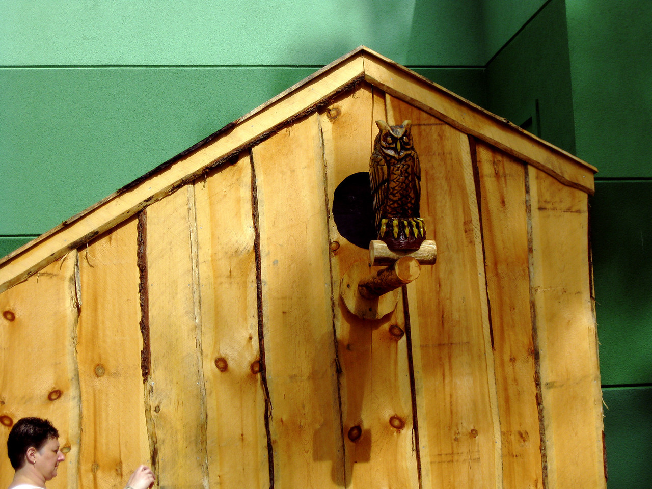 There's a wooden owl on the Midway Stage stair covering.