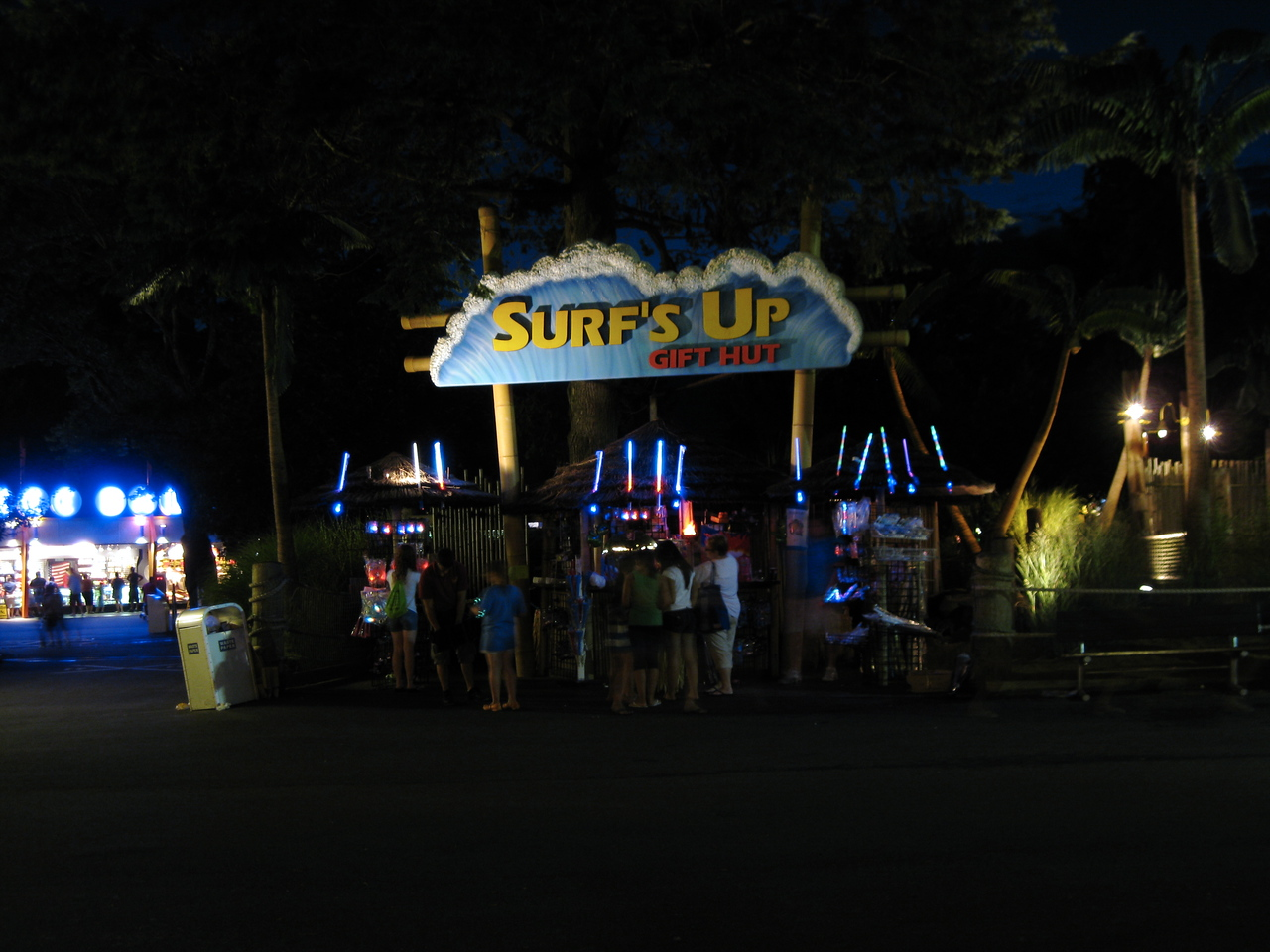 Surf's Up gift stand at night.
