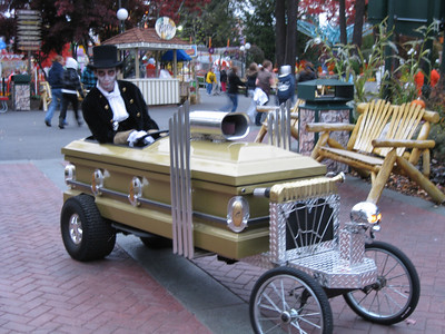 The coffin/casket car (blurry).