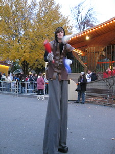 A stilt-walking juggler on the midway.