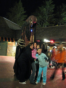 A stilt monster posing with guests.