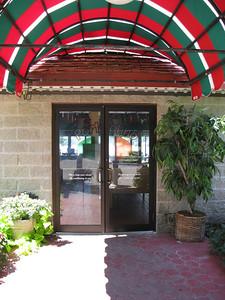 Portofino's front doors are now glass.