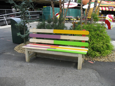 A wooden bench themed to look like it is made of popsicle sticks.