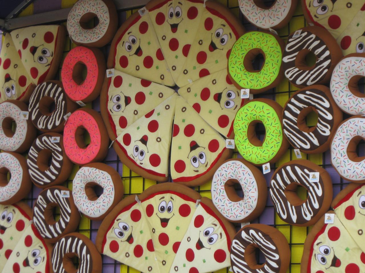 Doughnut and pizza plush prizes.