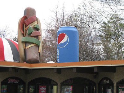 Hot dog and Pepsi can sculptures on top of International Food Festival.