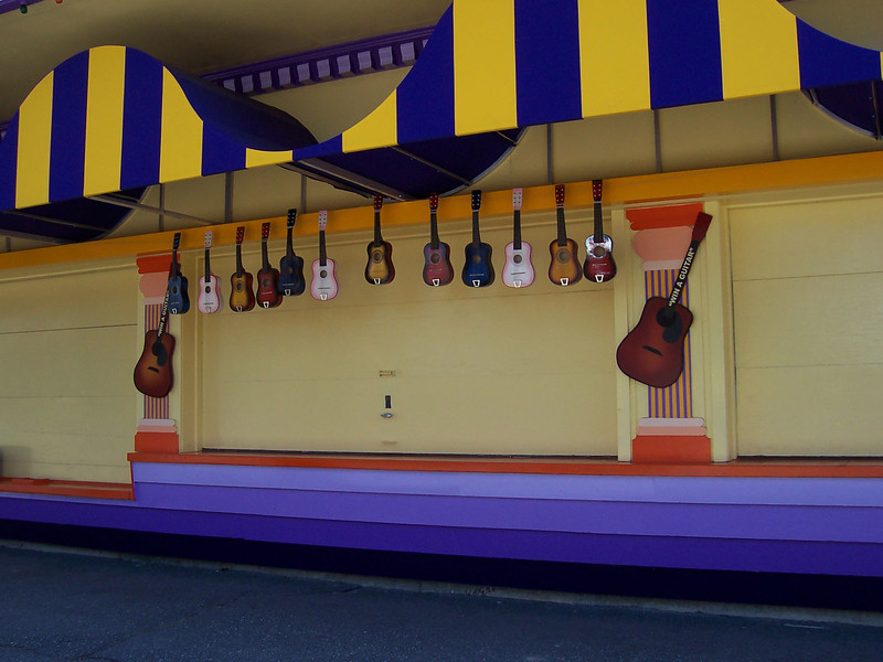 A games booth where the prizes are guitars.