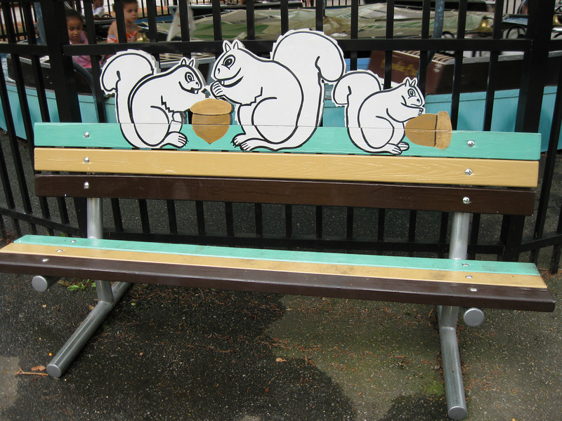Squirrel-themed bench.