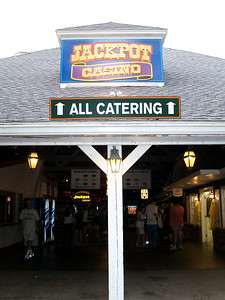 "This new ""All Catering"" sign was mounted on the Jackpot Casino building."