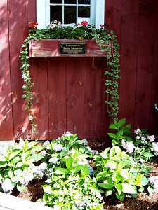 On the side of the Tattoo Barn, there was a small memorial garden for Tom Morrow.