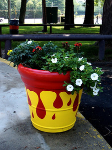 Decorative planter in the same ketchup-mustard colors.