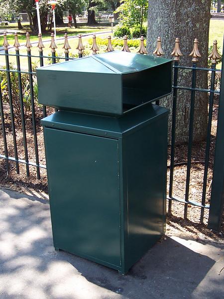 Green trash can near the Giant Sky Wheel.