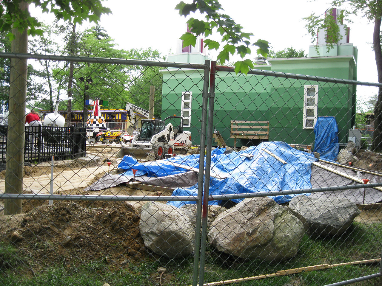The two ride pads in back of Kiddieland were still under construction.