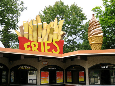 New fries and ice cream signs were on top of the International Food Festival building.