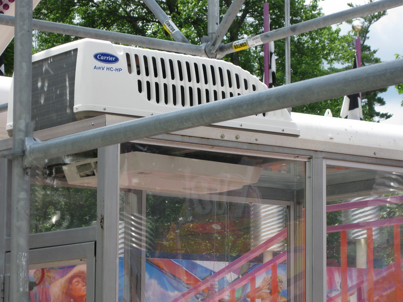 Air conditioning unit on top of the Xtreme Frisbee ride operator booth.
