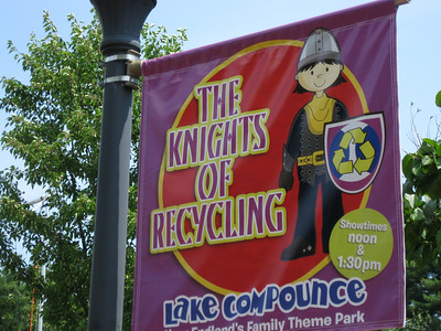Flag advertisement for t he Knights of Recycling kiddie show.