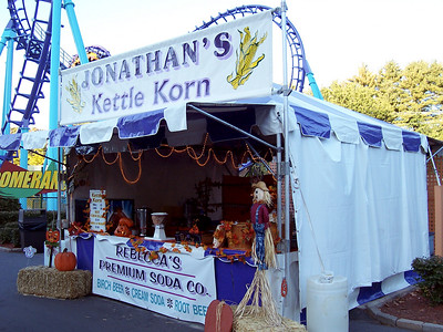 The Kettle Korn stand was on the midway between the Zoomerang and the Cirque En Vol stage entrances.