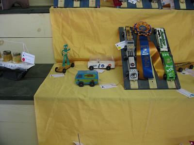 A Pinewood Derby car themed to look like the Scooby Doo Mystery Machine.