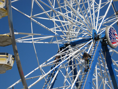 The Ferris wheel was receiving some maintenance.