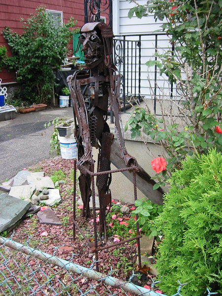 Guy with a walker made form junk.  Union St. in Brighton MA