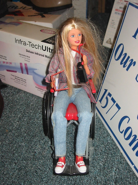 Wheelchair Barbie.  Found in the window of a medical supply store in Brighton, MA.