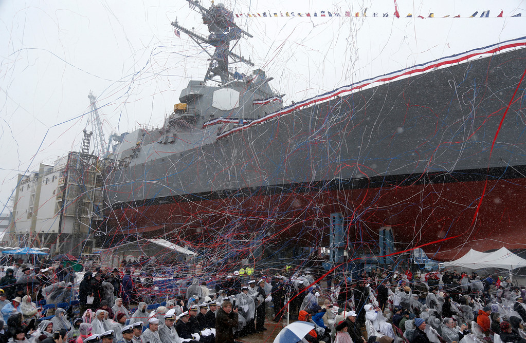 . Confetti and streamers fly as the future USS Thomas Hudner, a U.S. Navy destroyer named after Korean War veteran Thomas Hudner, is christened at Bath Iron Works in Bath, Maine, Saturday, April 1, 2017.  Hudner, a naval aviator who crash-landed his plane to try to save a downed pilot in the Korean War was honored with a ship bearing his name. (AP Photo/Mary Schwalm)