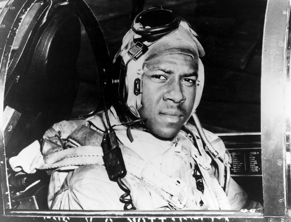 . This circa 1950 photo released by the U.S. Navy shows Jesse Brown in the cockpit of an F4U-4 Corsair fighter at an unidentified location. Brown, the first African-American naval aviator, died when he crashed behind enemy lines during the Korean War. Fellow aviator Thomas Hudner crash-landed his own plane in a futile attempt to save Brown. A U.S. Navy frigate was named for Brown in 1973. A U.S. Navy destroyer will be named for Hudner, where he is expected to attend the ceremony at age 92, Saturday, April 1, 2017, in Bath, Maine. (U.S Navy via AP)
