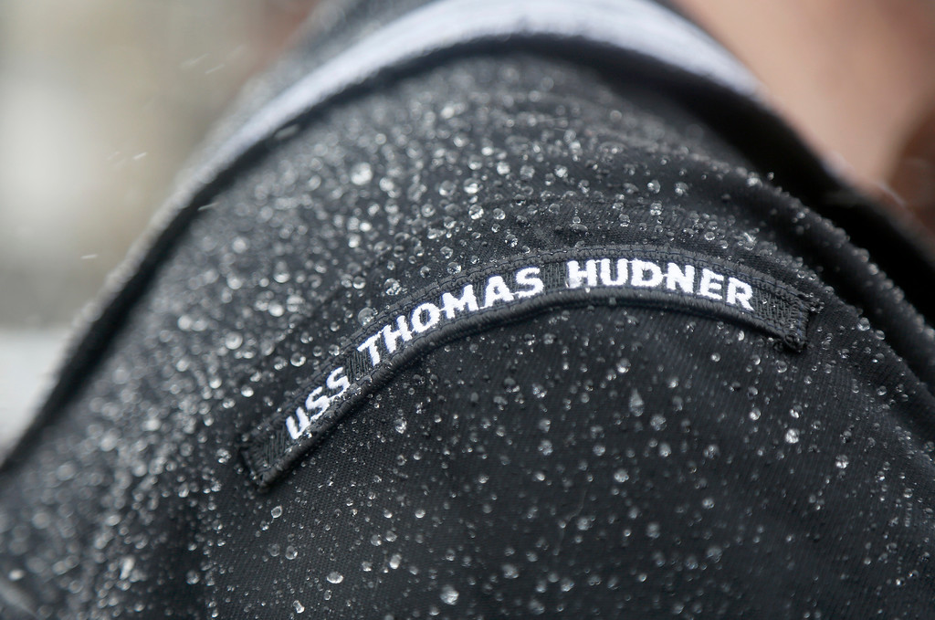 . Water droplets from rain and melting snow gather on the shoulder of a crew member of the the future USS Thomas Hudner, a U.S. Navy destroyer named after Korean War veteran Thomas Hudner, during the ship\'s christening ceremony at Bath Iron Works in Bath, Maine, Saturday, April 1, 2017.   Hudner, a naval aviator who crash-landed his plane to try to save a downed pilot in the Korean War was honored with a ship bearing his name. (AP Photo/Mary Schwalm)