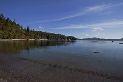 A subtle wavelet mirrors the angle of the lines in the sky. -  Beecher Bay, in East Sooke Regional Park.