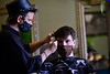 """Jeremy """"Remy"""" Anderson, owner of Main Street Hair, in Brattleboro, Vt., cuts the hair of Matt Dulmaine, of Brattleboro, on Tuesday, April 6, 2021. Anderson is holding an essay contest to give his barbershop away as he plans to open up a new shop in Spain."""