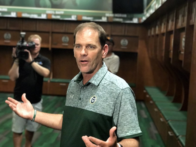Colorado State head football coach Mike Bobo shows off the team's new locker room within the on-campus stadium Tuesday July 18, 2017 in Fort Collins. (Cris Tiller / Loveland Reporter-Herald)