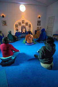 Morning meditation in the community temple.