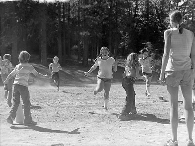 A relay race during a track meet with other nearby schools. At right is Melissa. I forget her last name.